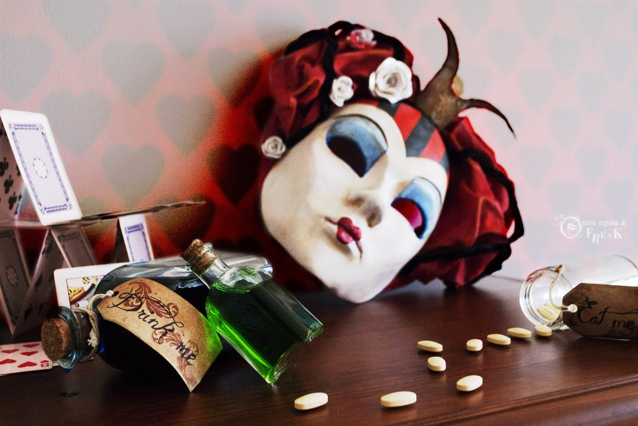 queen of hearts venetian mask drink me bottle and pills